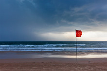 Storm Warning Flags On Beach. ...