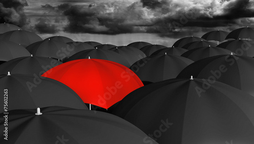 Fotografiet  Individuality and different concept of a red umbrella in a crowd