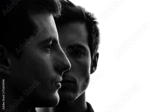 close up portrait two  men twin brother friends silhouette Canvas Print