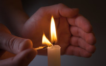 Hands Kindle Candle