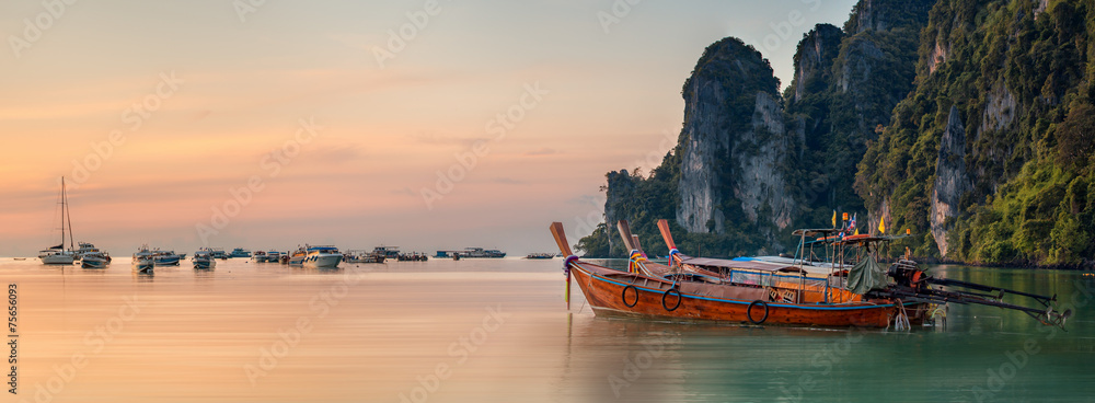 Fototapeta sunset with colorful sky and boat on the beach