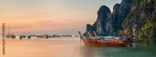 Fototapeta sunset with colorful sky and boat on the beach obraz
