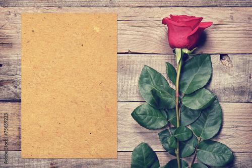 Fototapeta Vintage rose and blank paper on old wooden background obraz na płótnie