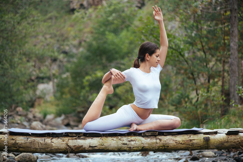 Woman doing yoga in nature Wallpaper Mural