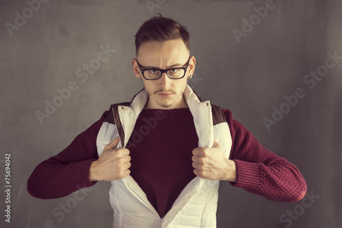 Photo  Casual young businessman as a superhero