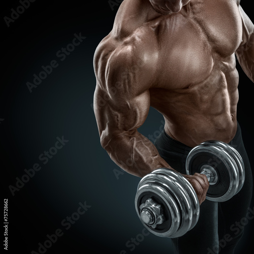 Strong and power bodybuilder doing exercises with dumbbell Canvas Print