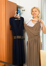 Mature Woman Looking At Clothes
