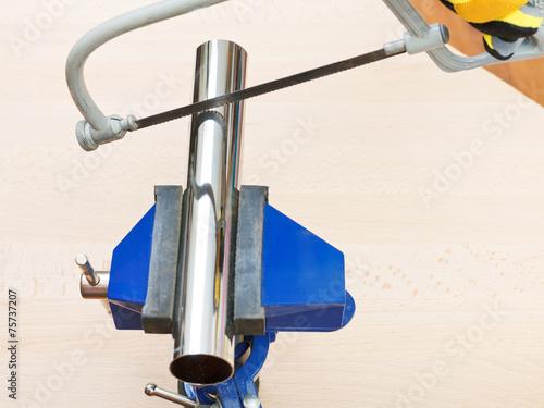 Fotografie, Obraz  hacksaw saws chrome plated plumbing drain pipe