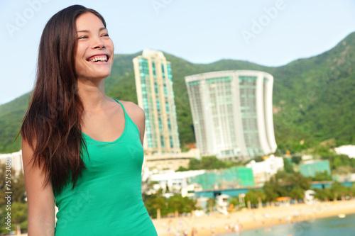 Photo  Hong Kong tourist woman at Repulse Bay beach