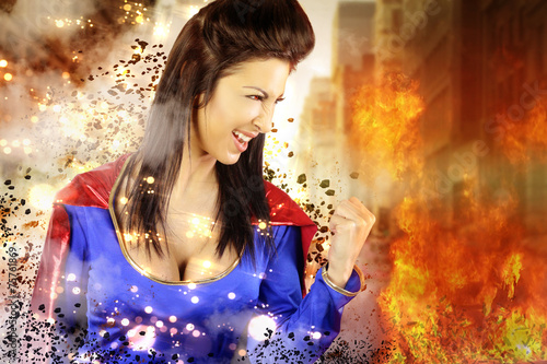 young woman dressed as a superhero shows its power Canvas Print