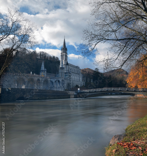 Photo  Sanctuaries of Lourdes from the border of Gave de Pau River