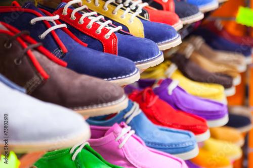 Fotografia  sport shoes at fashionable shop