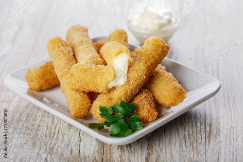 Fotografia  fried mozzarella cheese sticks breaded