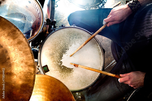Tablou Canvas Man playing the drum.Live music background concept.Drummer