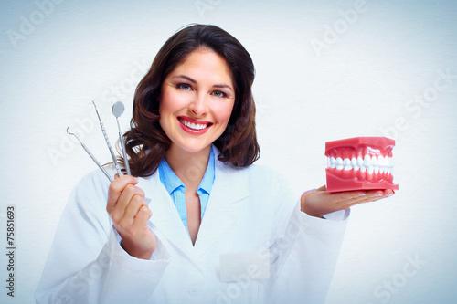 fototapeta na drzwi i meble Dentysta kobieta.