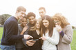canvas print picture - Multiethnic Group of Friends Looking at Mobile Phone