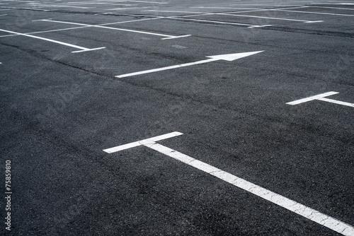 Fotografia  Asphalt surface of the parking with road marking lines