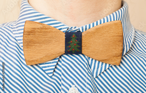Fragment man suit hipster wooden bow tie on the shirt. Wallpaper Mural
