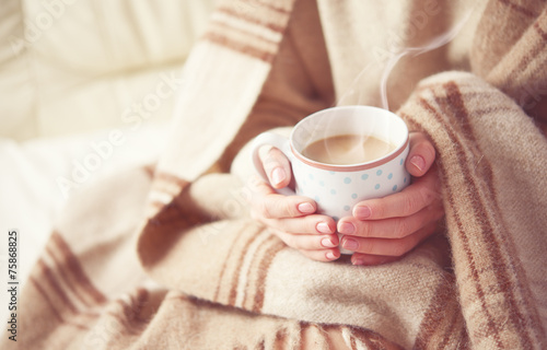 Obraz cup of hot coffee warming in the hands of a girl - fototapety do salonu