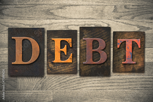 Fotografía  Debt Concept Wooden Letterpress Type