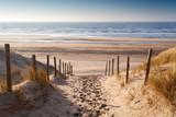 Fototapeta Fototapety z morzem do Twojej sypialni - sand path to North sea at sunset