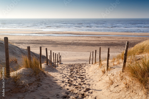 Montage in der Fensternische Kuste sand path to North sea at sunset