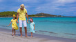 Young father and little girls have fun together during tropical