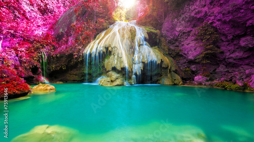 Photo sur Toile Cascade wonderful waterfall with colorful tree in thailand
