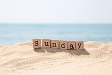Sunday Word And Blue Ocean Background