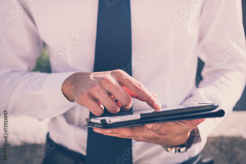 Fototapeta close up businessman man hand using tablet device obraz na płótnie