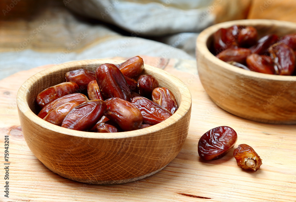 Fototapety, obrazy: Fruits dates in wooden bowl  on  table