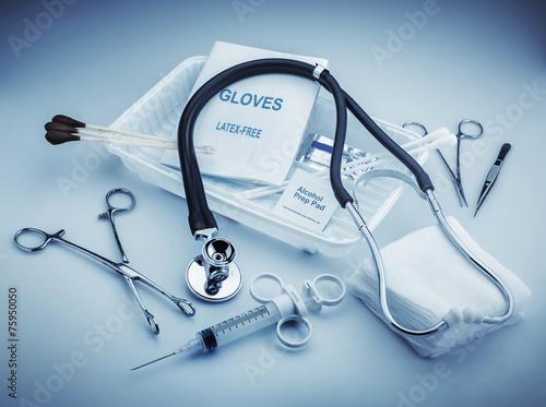 Fotografering  Medical instruments for ENT doctor on pale blue