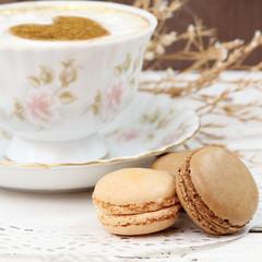 Fototapeta Do kawiarni Macaroons traditional Parisian cookie with cup of coffee