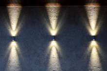 Wall With Three Lamps That Shine Up And Down
