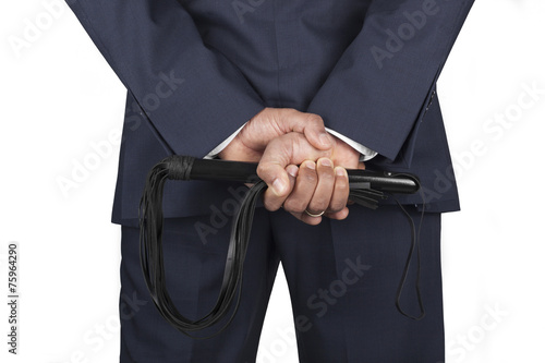 Photo  Leather whip held by dominant master in a suit