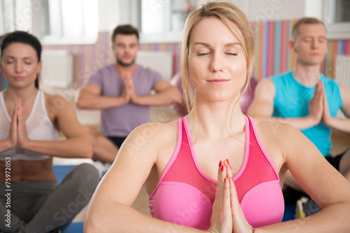 Yoga class in fitness club