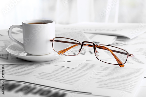 Glasses and newspapers, close-up Wallpaper Mural