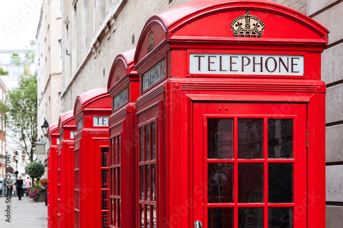 Traditional red telephone booths in London Poster