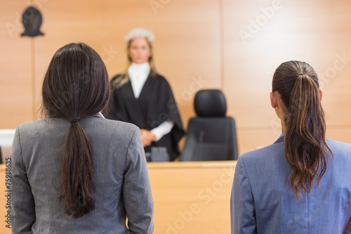 Fototapeta Lawyers listening to the judge