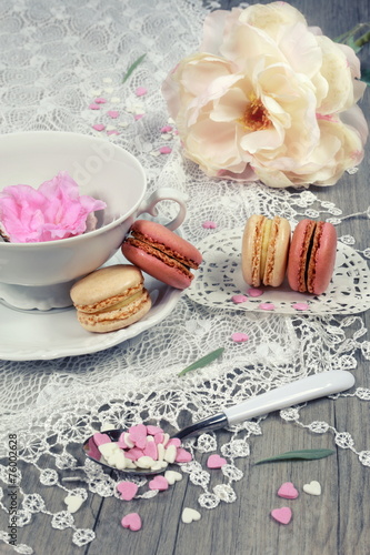 Fotografie, Obraz  Valentine's Day: Romantic tea drinking with macaroon and hearts