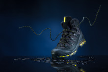 Mountain Boots On A Dark Background