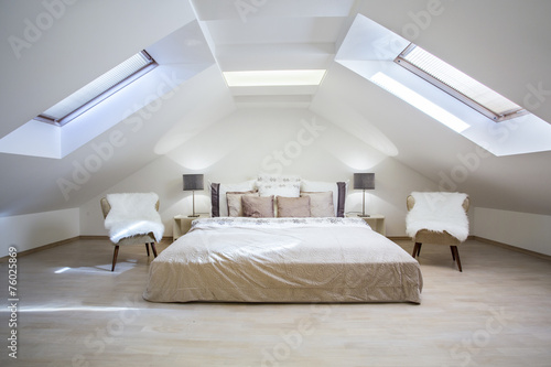 Obraz na plátně Bright attic bedroom in the  apartment