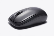 Black Wireless Computer Mouse On A White Background