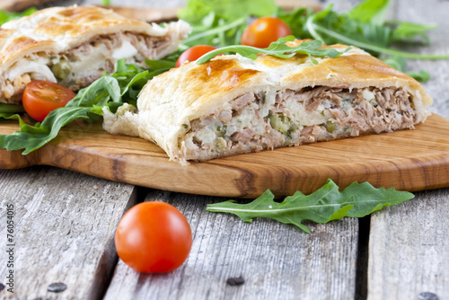 Staande foto Snack pie of puff pastry with tuna, rice and egg