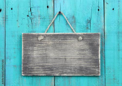 Fotografie, Obraz  Blank wood sign on teal blue wooden background