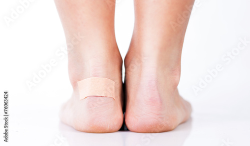 Closeup of woman's heel with blister plaster on Canvas Print