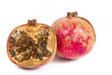 Rotten Pomegranate On A White Background