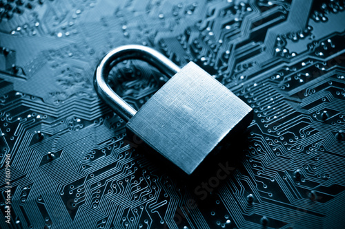 Photographie security lock on computer circuit board - computer security