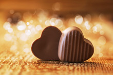 Chocolates Hearts On A Wooden Background