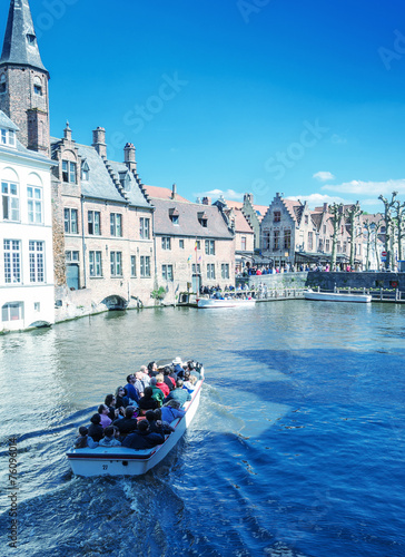 In de dag Brugge BRUGES, BELGIUM - MAY 15, 2012: Tourists enjoy city life on a be